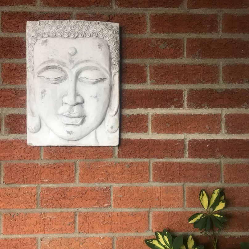 buddha plate on wall